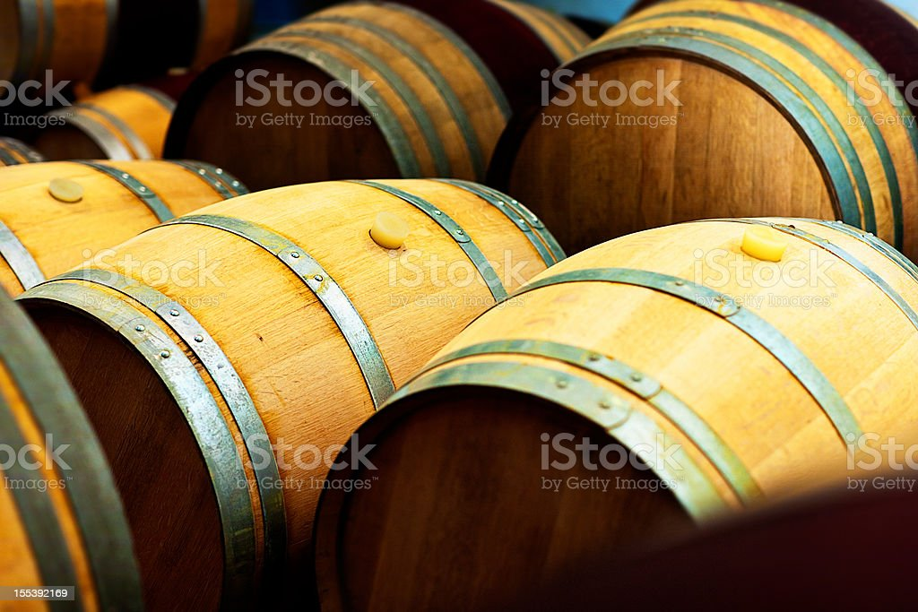 Oak barrels for maturing wine at a winery stock photo