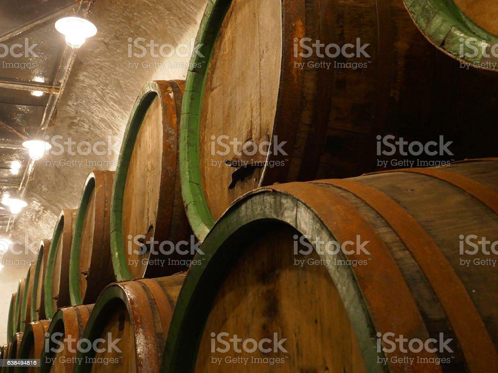 Oak Barrels in a Cellar stock photo