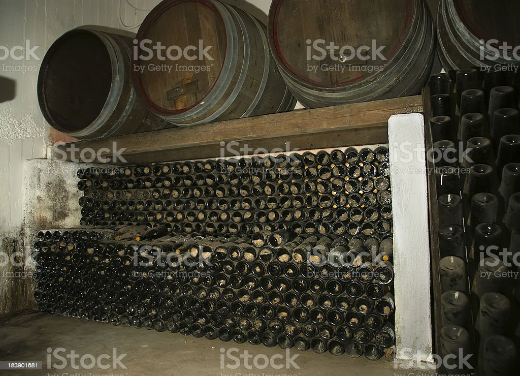 Oak barrels in which the wine matures at a winery royalty-free stock photo