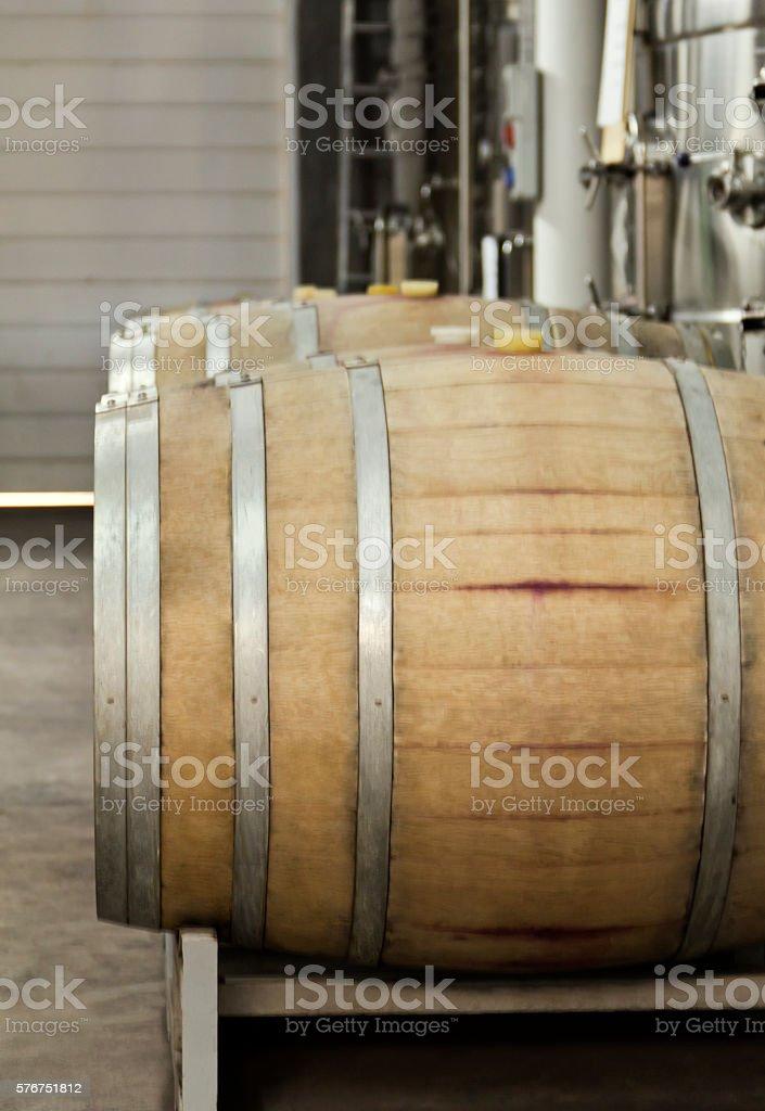 Oak barrels inside of a winery stock photo