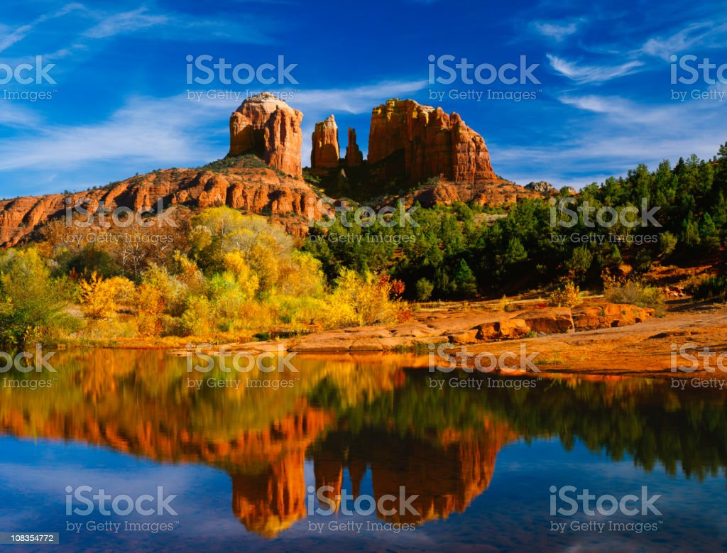 Oak Creek reflects Cathedral Peaks  in Red Rocks State Park royalty-free stock photo
