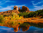 Oak Creek reflects Cathedral Peaks  in Red Rocks State Park