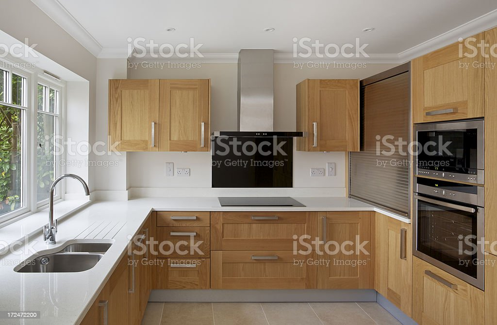 oak fitted apartment kitchen royalty-free stock photo