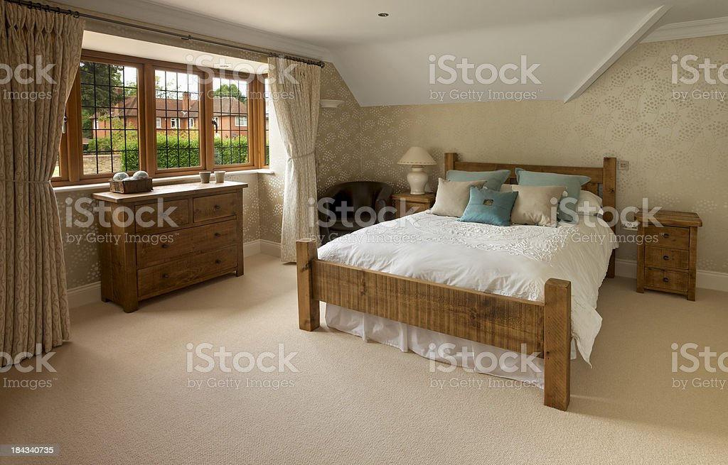 oak furnished rustic bedroom stock photo