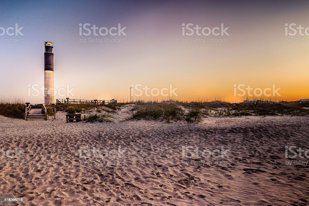 Oak Island Lighthouse viewed from the beach stock photo