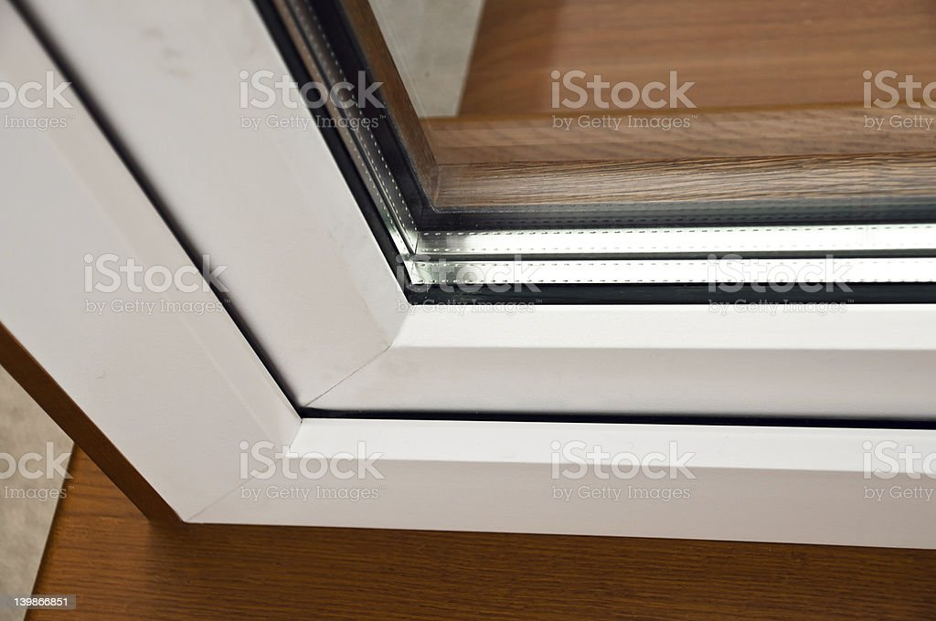 Oak laminated fiberglass window with gold handle stock photo