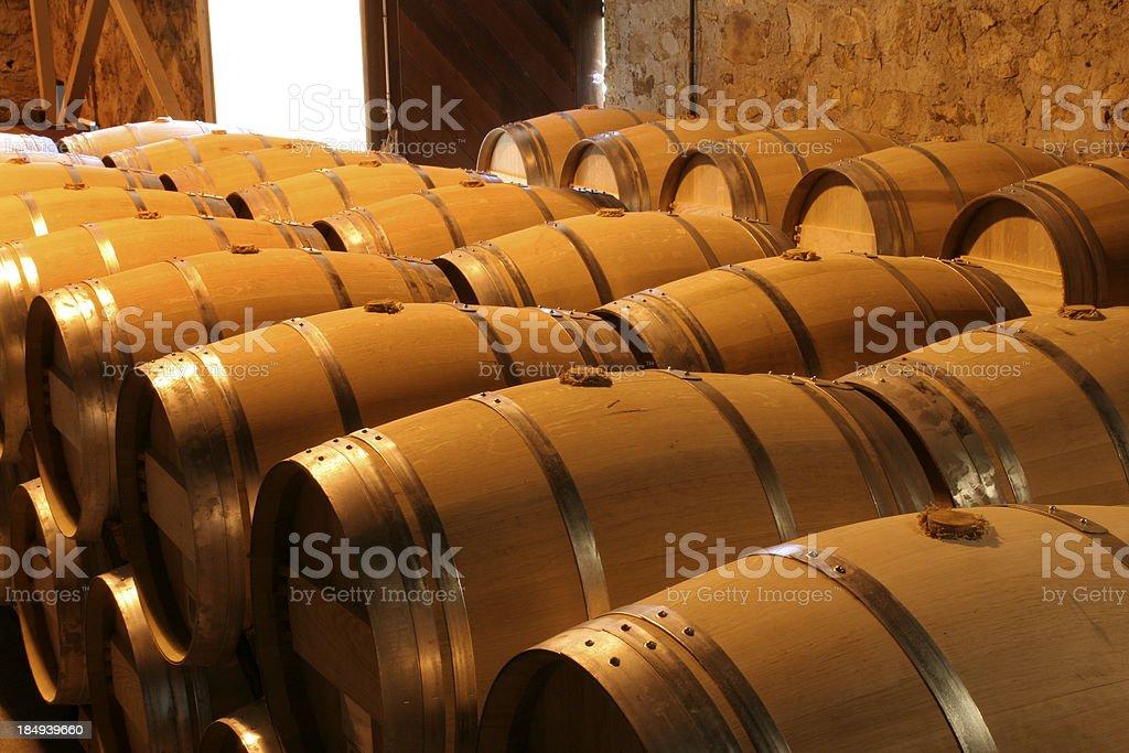 Oak Wine Barrel Rows in Winery Cellar, Napa Valley, California stock photo