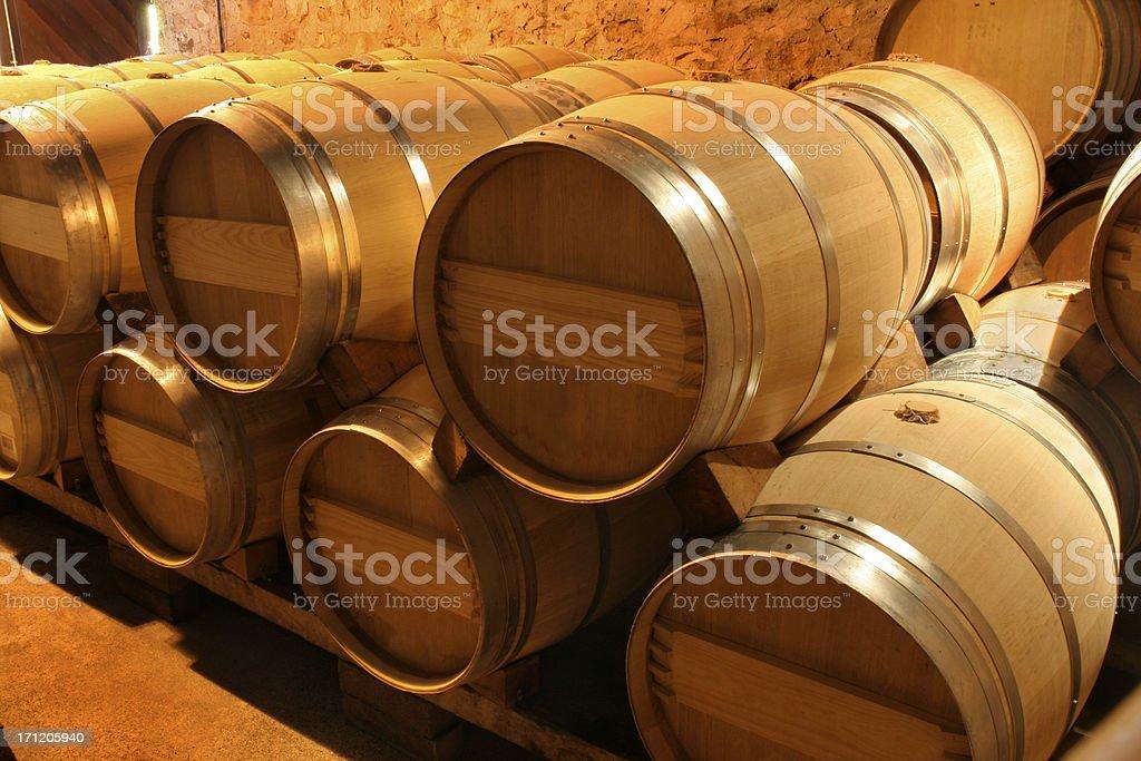 Oak Wine Barrel Stacks in Winery Cellar, Napa Valley, California royalty-free stock photo