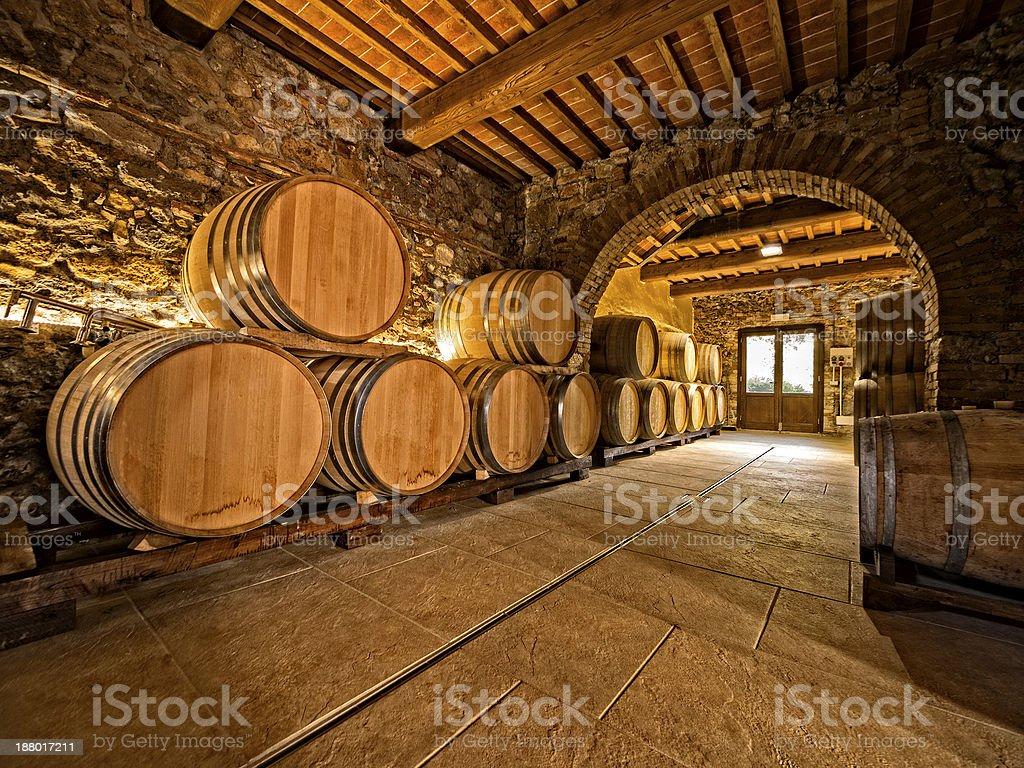 oak wine barrels in cellar stock photo