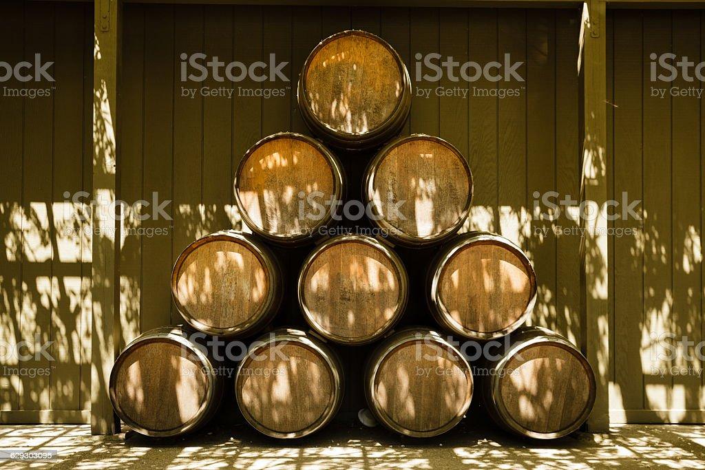 Oak Wine Barrels Stacked at Winery outdoors, Napa Valley, California stock photo