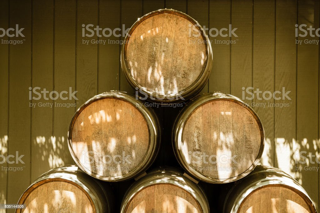 Oak Wine Barrels Stacked at Winery outdoors, Napa Valley, California stock photo