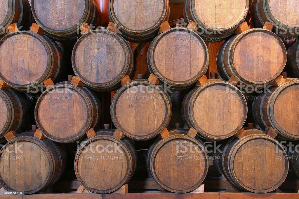Oak Wine Barrels Stacked in Winery Cellar, Napa Valley, California stock photo