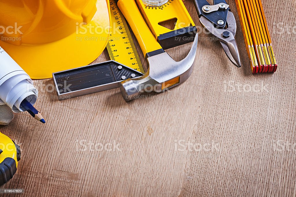 Oaken wooden board with variation of building working tools repa stock photo