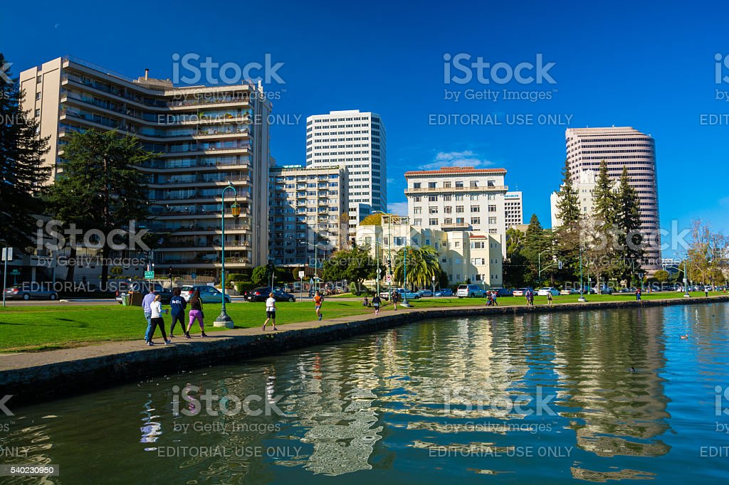 Oakland Downtown Skyline and Waterfront with People Exercising stock photo