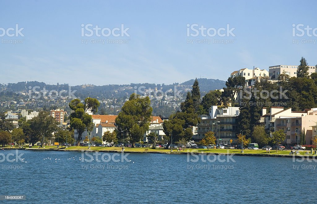 Oakland's Lake Merritt, park, and apartment buildings stock photo