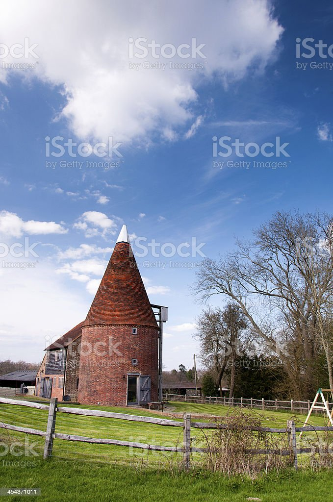 Oast house with yard stock photo
