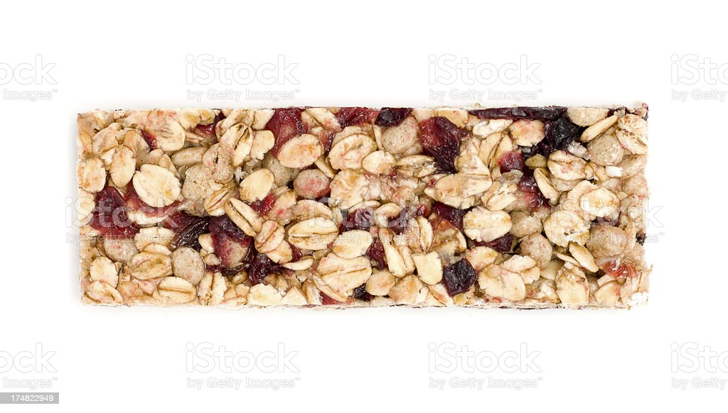 Oat and red berry granola bar on a white background royalty-free stock photo