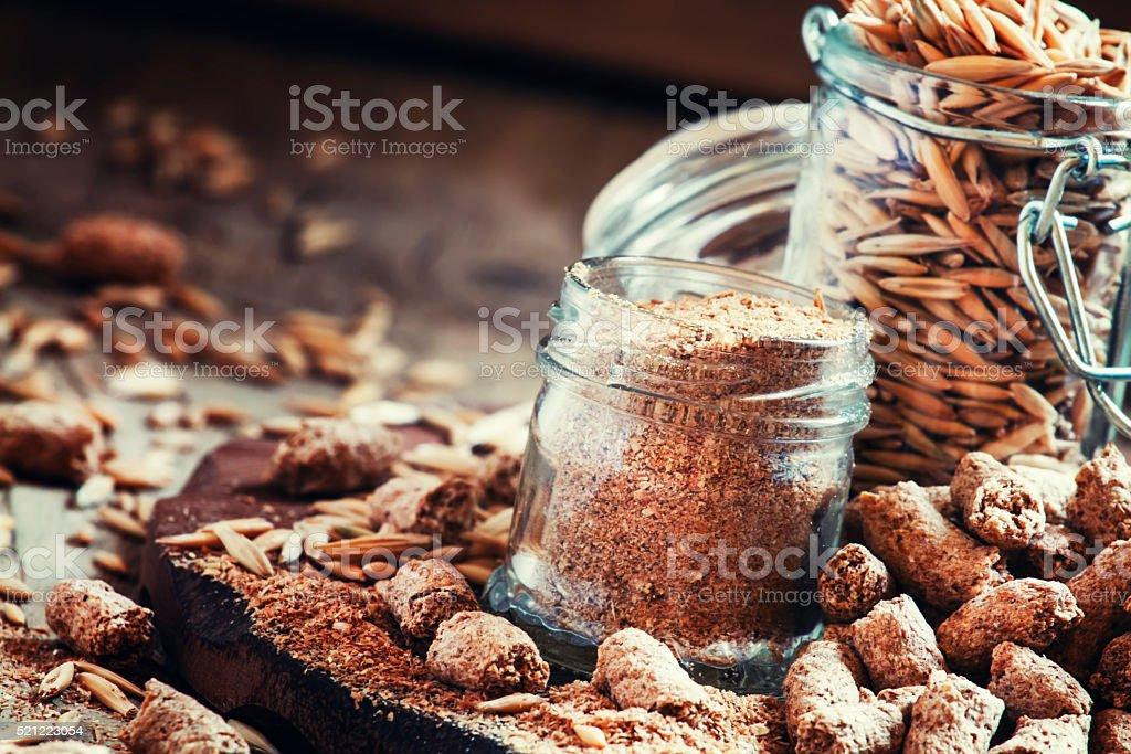 Oat bran, grain oats, oat flour, in glass jars stock photo