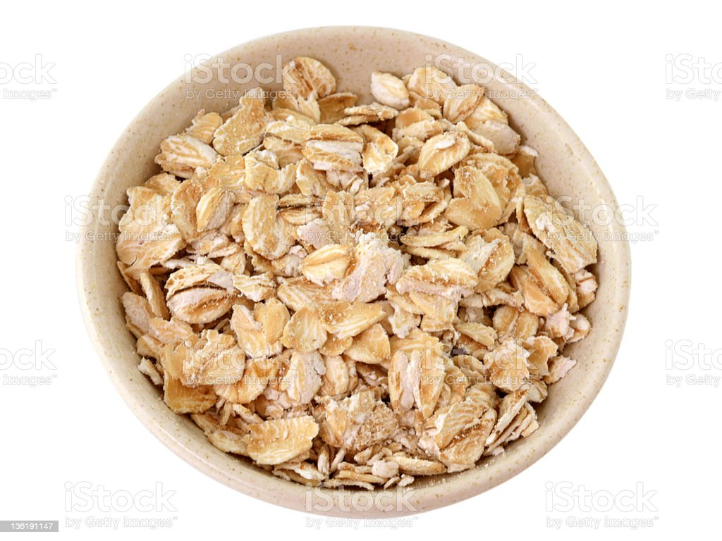 Oat Flake in a bowl isolated on white royalty-free stock photo