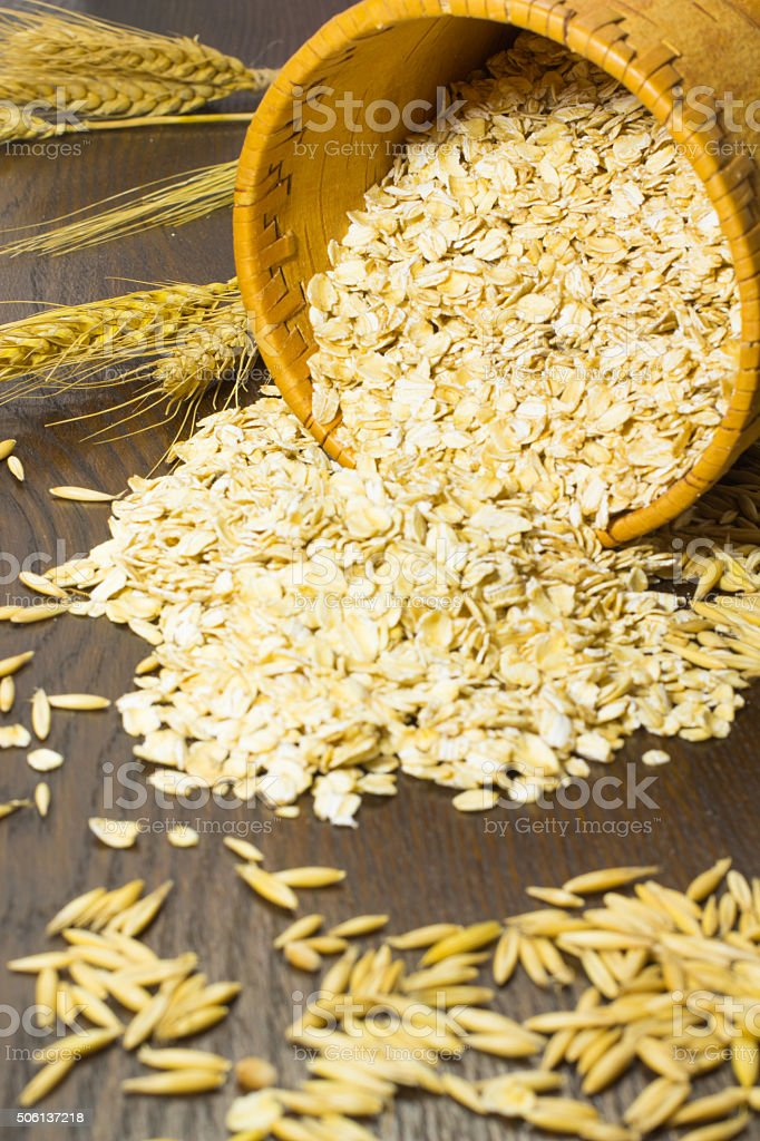 Oat flakes in a birch-bark basket stock photo