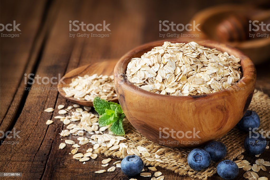 Oat flakes in a bow stock photo