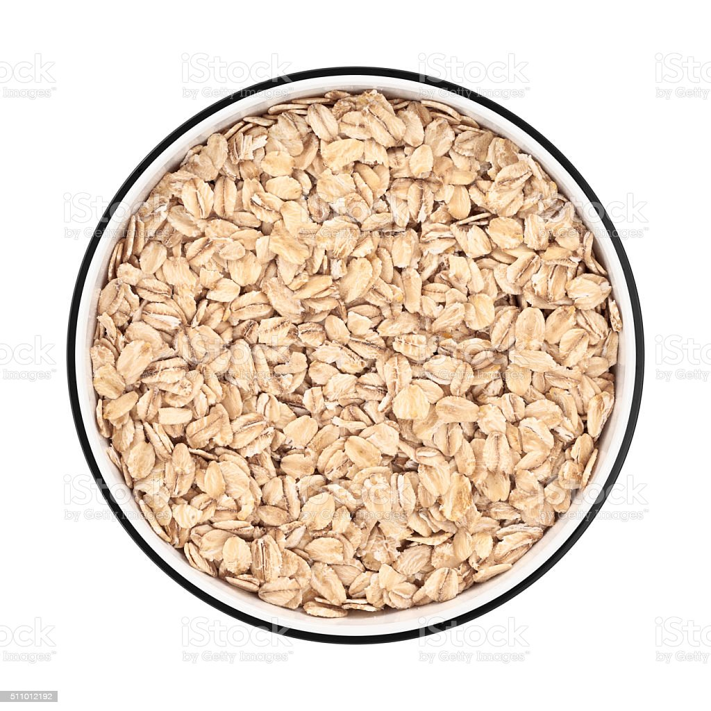 Oat flakes in a bowl from directly above stock photo