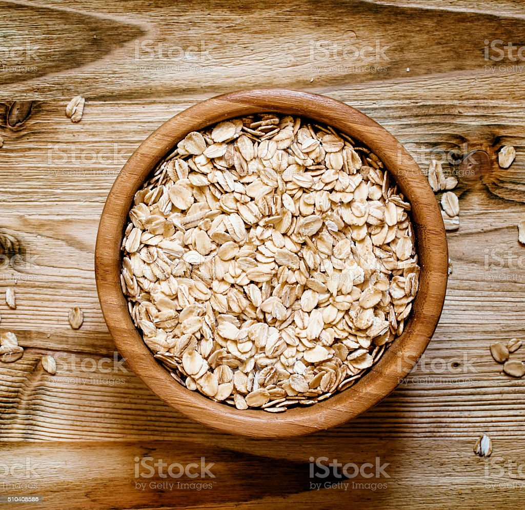 Oat flakes in a round bowl stock photo
