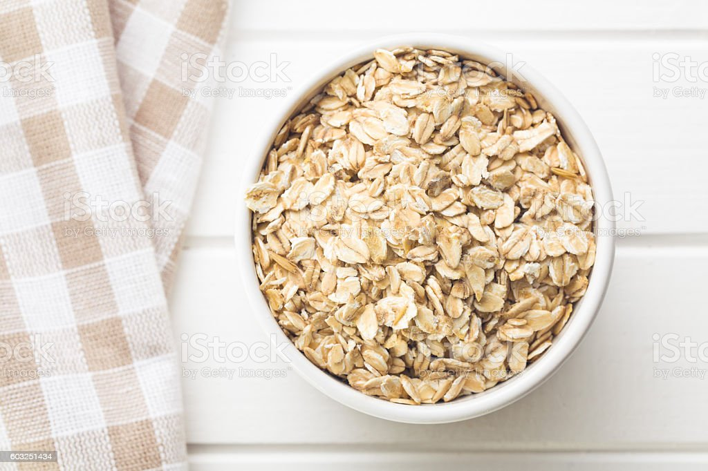 oat flakes in bowl stock photo