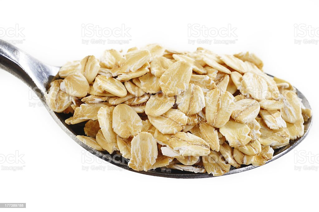 oat flakes in spoon royalty-free stock photo