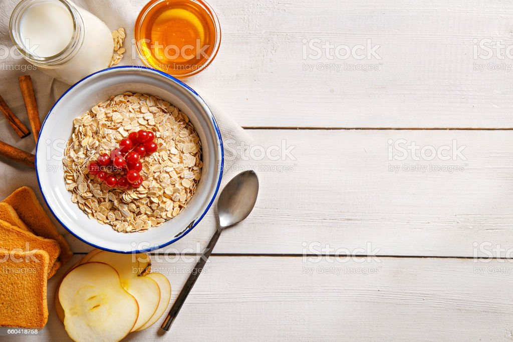 Oat flakes plate with honey stock photo