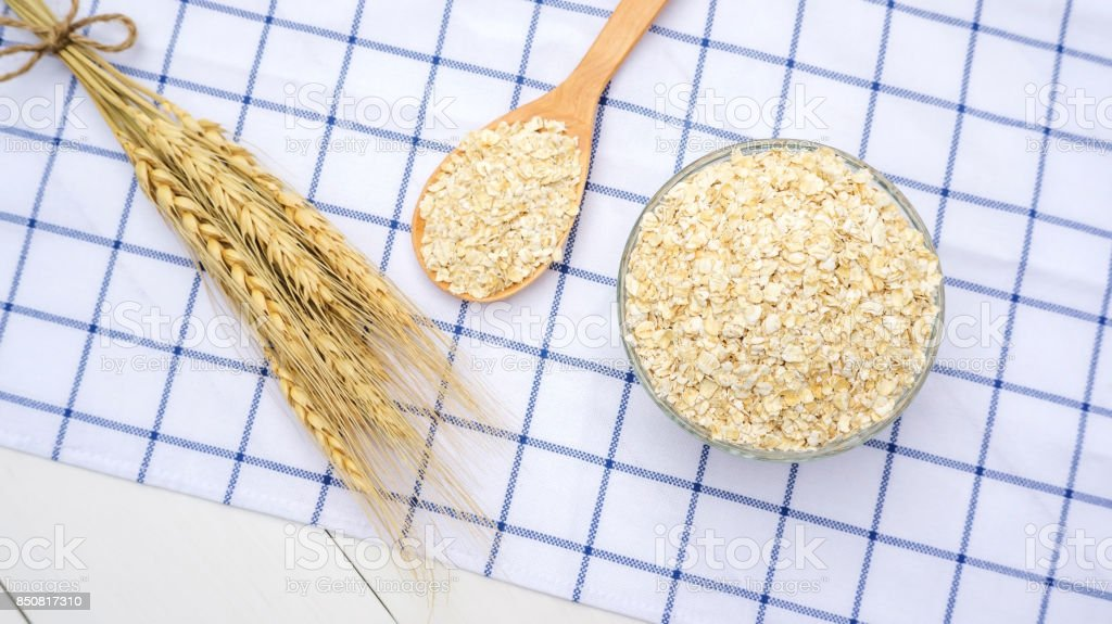 Oat in a bowl on a wooden table. stock photo