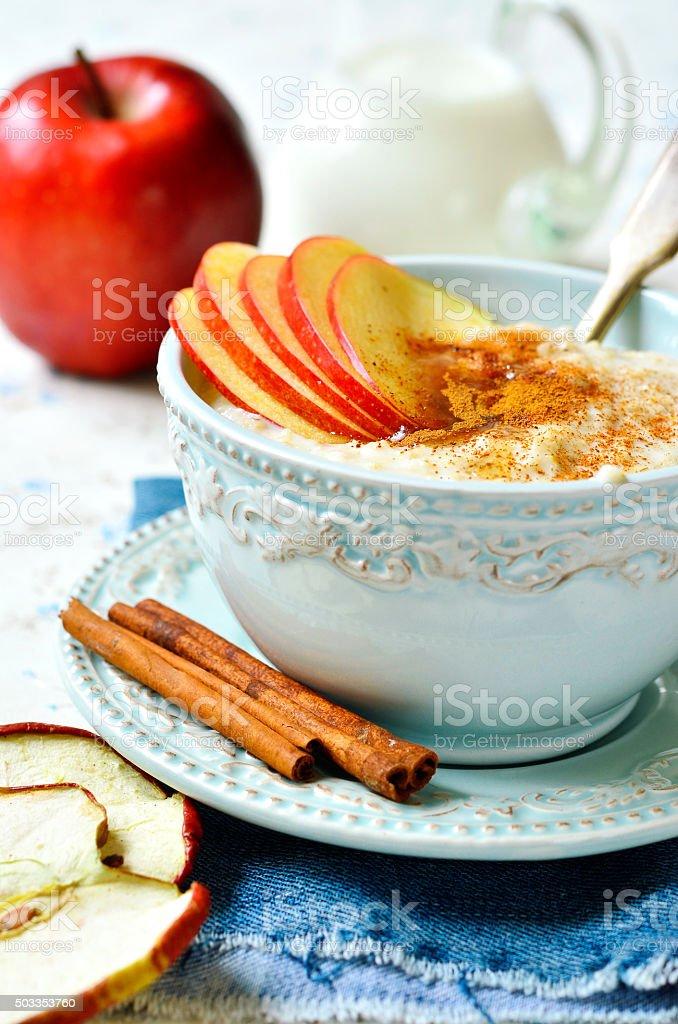 Oat porridge with apple,honey and cinnamon. stock photo