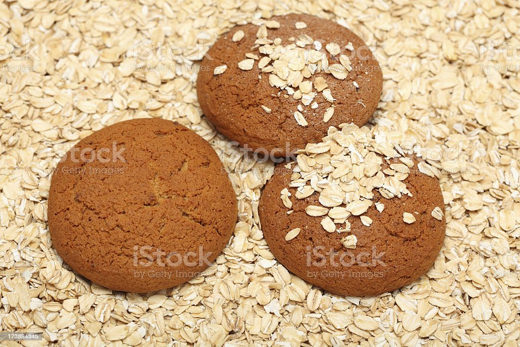 Oatcakes on rolled oats background royalty-free stock photo
