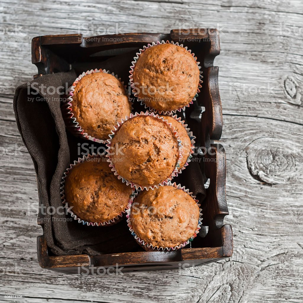 Oatmeal and banana  muffins in vintage tray stock photo