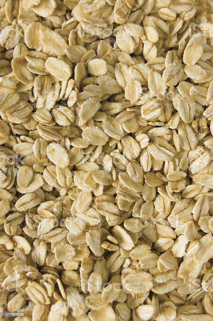 Oatmeal background, rolled raw oats, detailed macro closeup vertical royalty-free stock photo