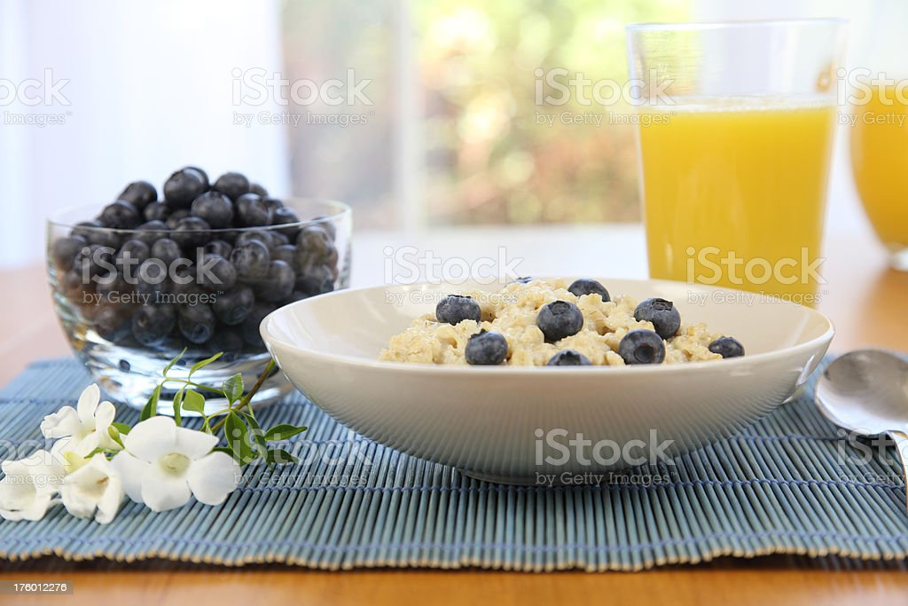Oatmeal, Blueberries, and Orange Juice royalty-free stock photo