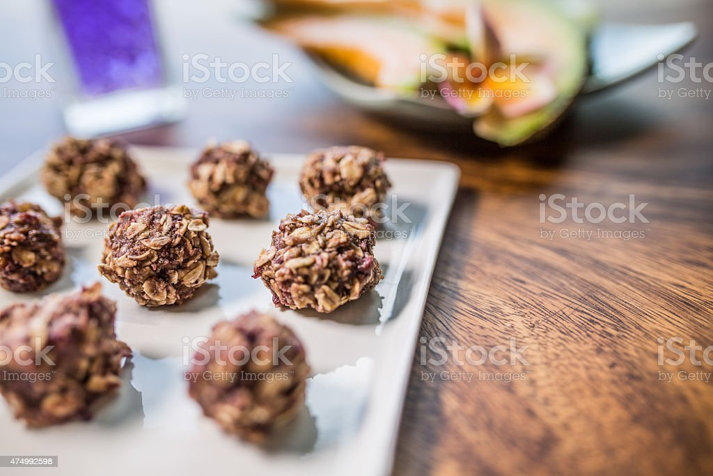 Oatmeal bolls with banana, melon, berry and nuts stock photo