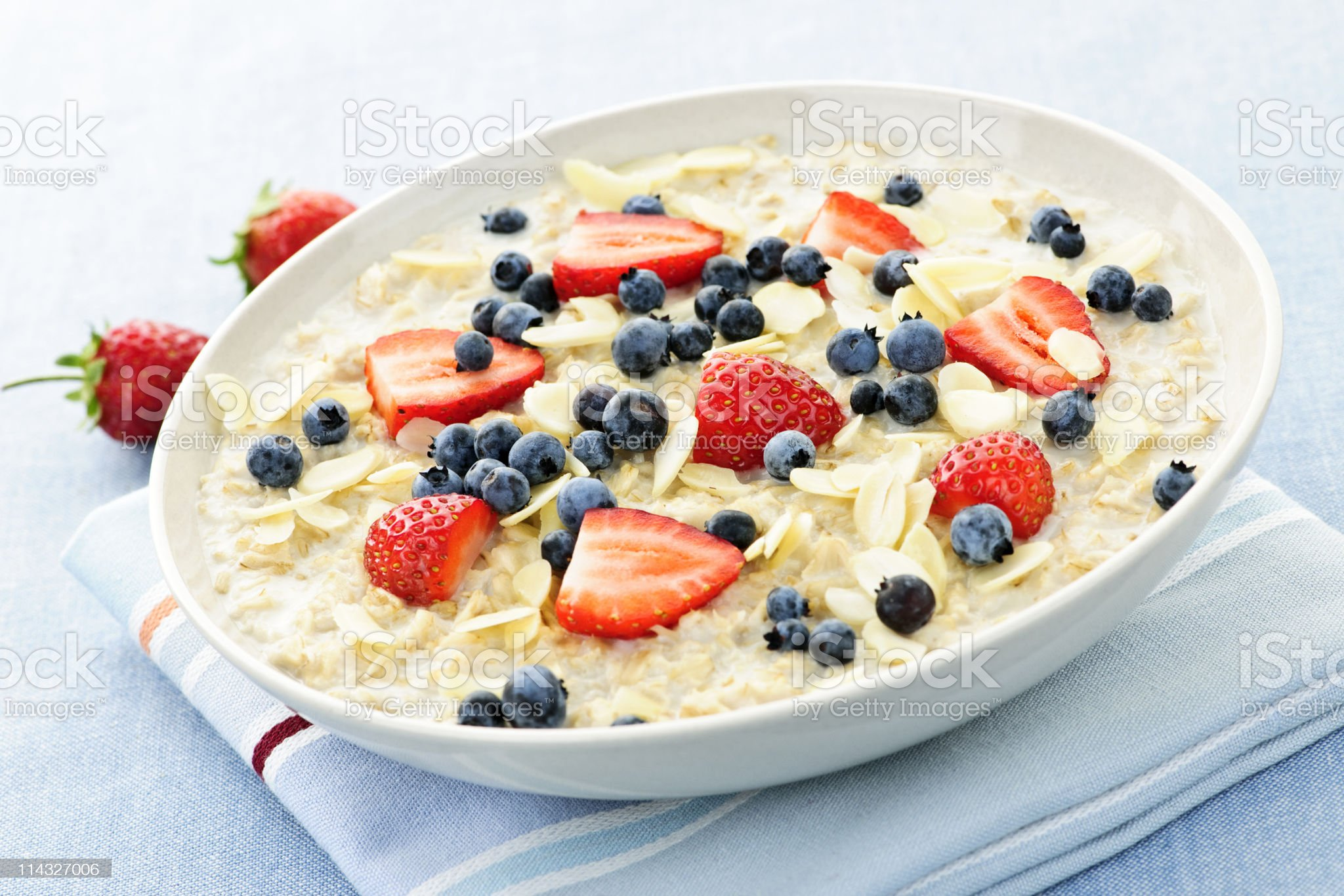 Oatmeal breakfast cereal with berries royalty-free stock photo