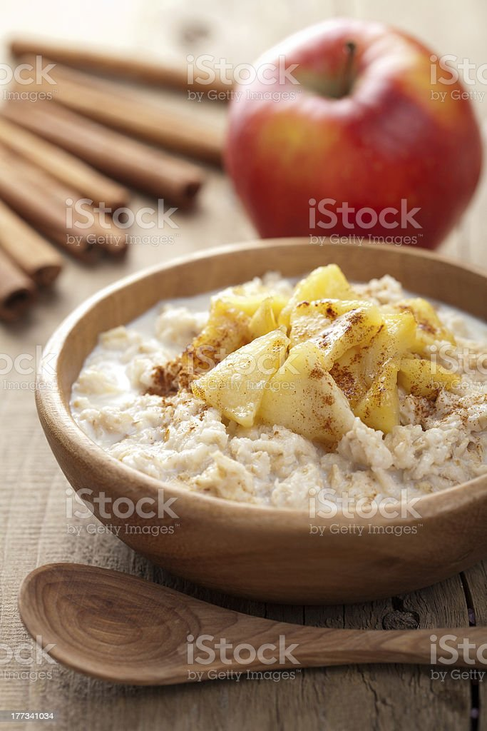 Oatmeal, caramelized apple, and wooden dining ware stock photo