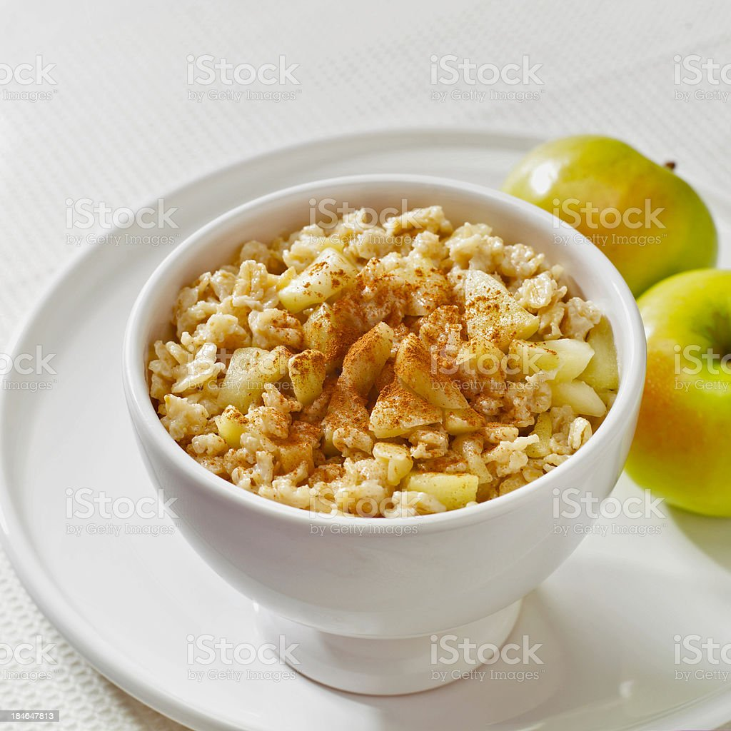 Oatmeal cereal with apples & cinnamon stock photo