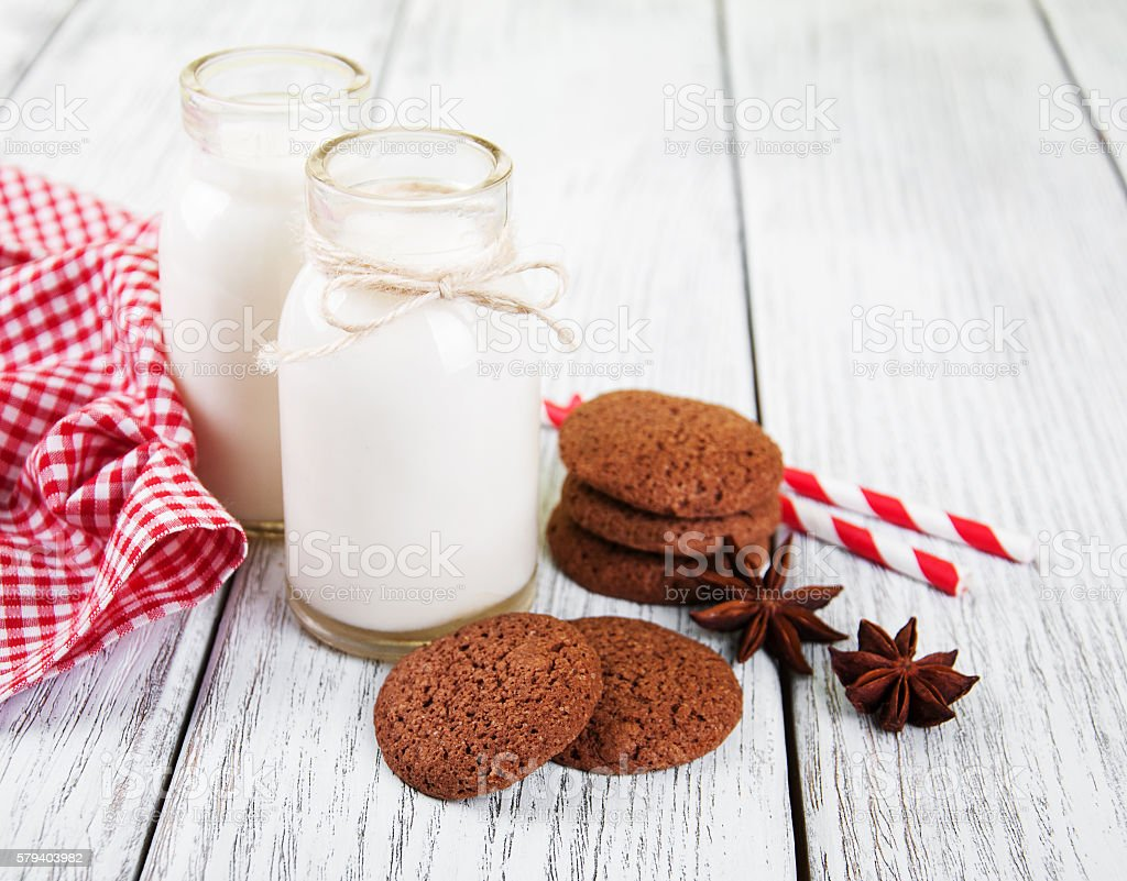 oatmeal cookies and bottles of milk stock photo