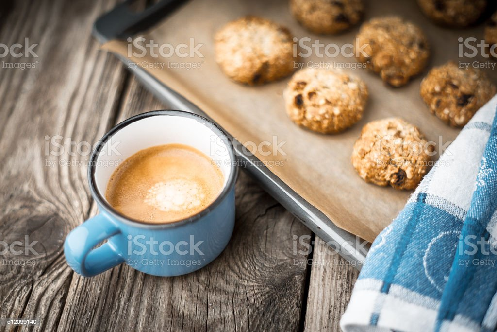 Oatmeal cookies and coffee cup on a wooden table stock photo