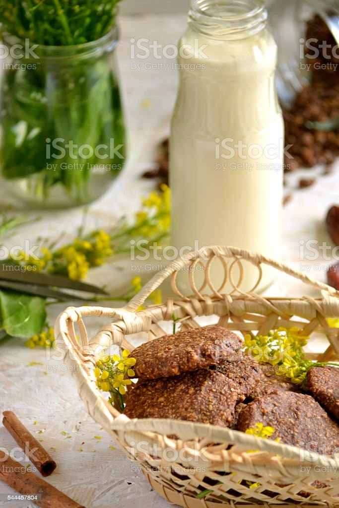 oatmeal cookies in a basket with a bottle of milk stock photo