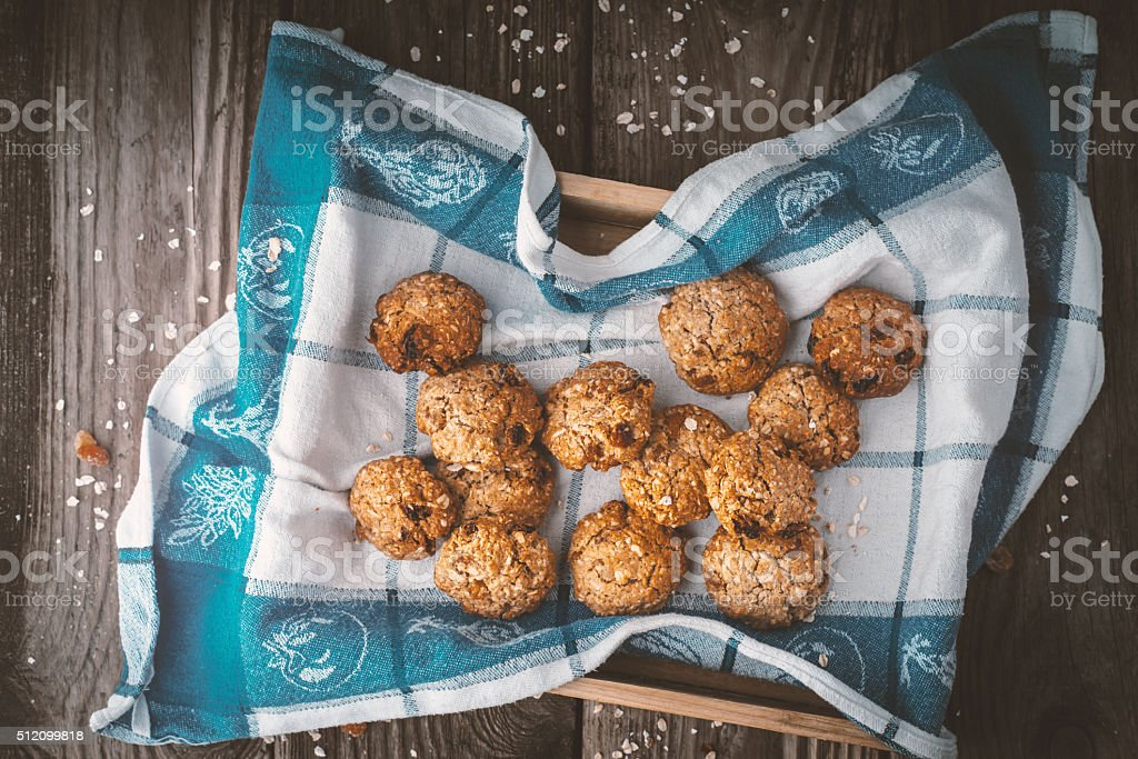 Oatmeal cookies on a towel on the wooden table stock photo