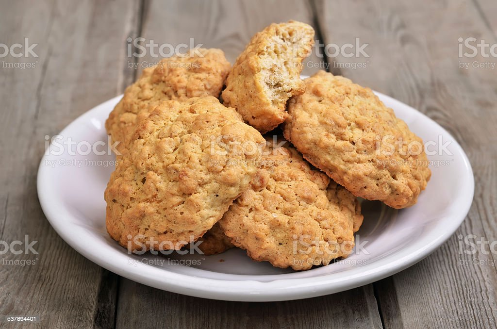 Oatmeal cookies on rustic table stock photo