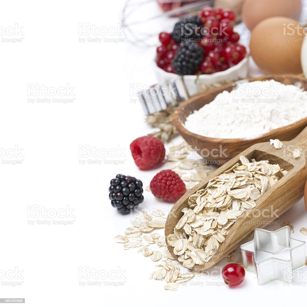 oatmeal, flour, eggs and berries - the ingredients for baking stock photo