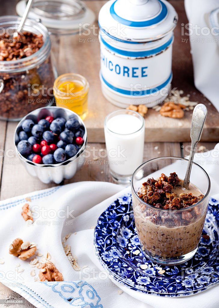 Oatmeal granola glazed with molasses, coffee, milk, fresh berries. stock photo