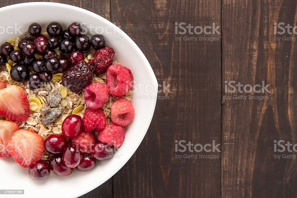 Oatmeal in bowl topped with fresh blueberries, cranberries, stra stock photo