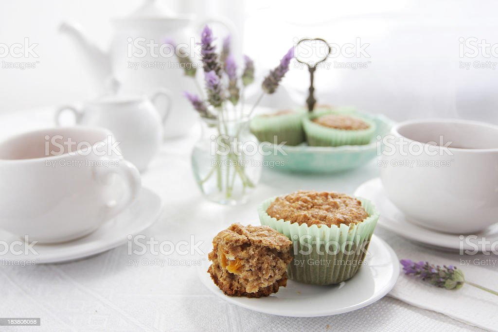 Oatmeal muffins with green liner and tea service royalty-free stock photo