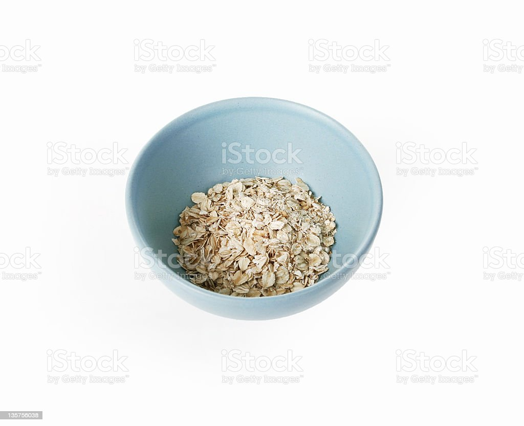 Oatmeal on a turquoise plate royalty-free stock photo